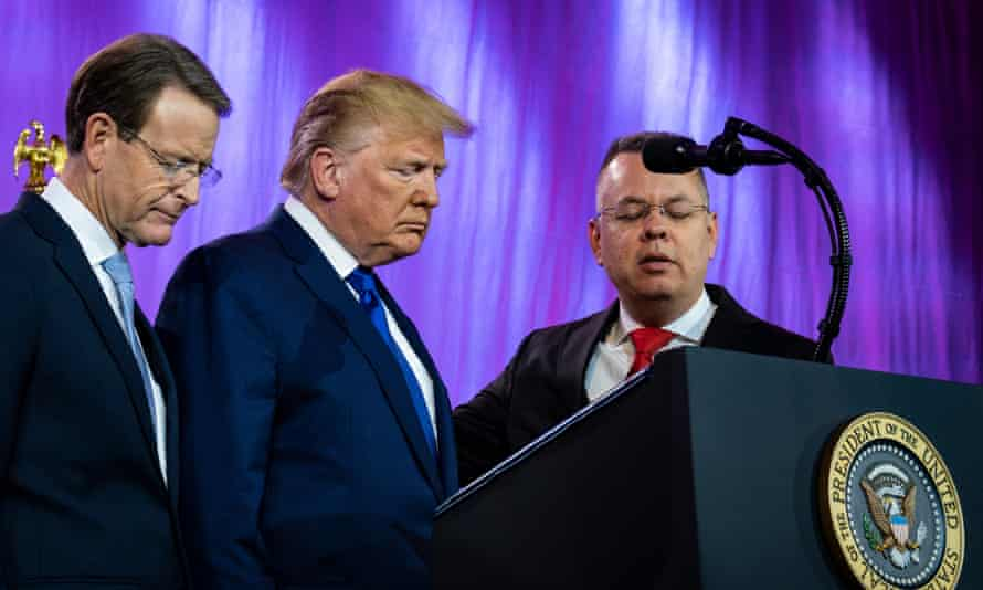 Donald Trump prays with Tony Perkins, the president of the Family Research Council, and Pastor Andrew Brunson, at the Values Voter Summit.