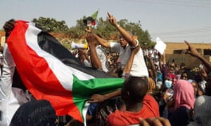 Sudanese protesters wave the national flag during an anti-government demonstration in the capital Khartoum's twin city of Omdurman.