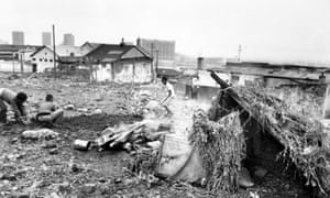 1980: Youths clear rubble in District Six where a house was bulldozed by the government.