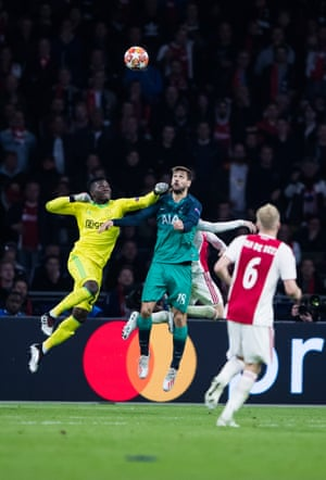 Ajax keeper André Onana beats Fernando Llorente to the ball as Spurs push for another goal