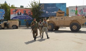 Afghan security forces patrol in Kunduz during a Taliban attack on Saturday.