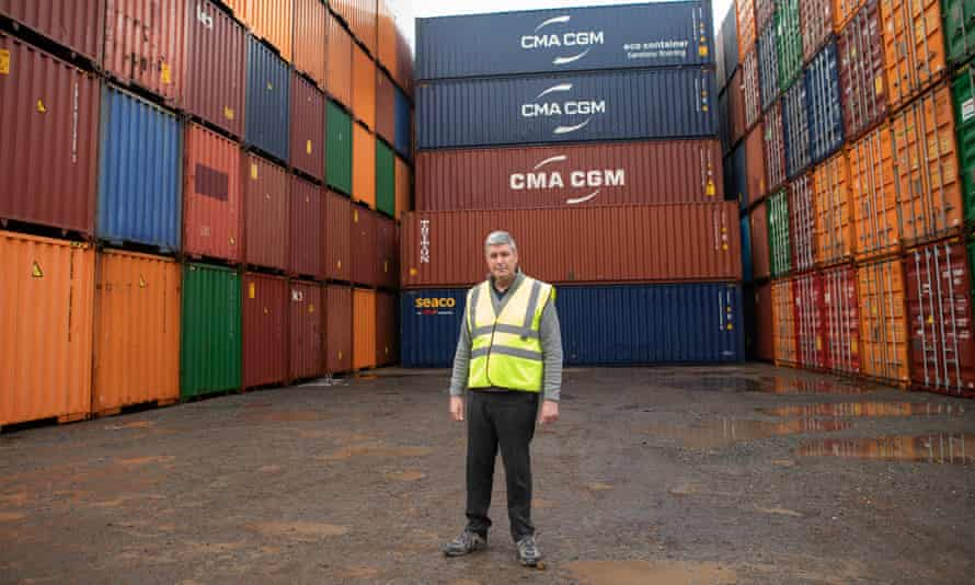 Bill White, general manager of storage and haulage company Eldapoint, stands in front of his empty containers at Southampton docks.