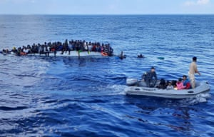 Mediterranean SeaMigrants on a rubber dinghy are pictured during a rescue operation, off the coast of Libya