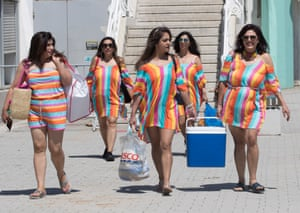 A group of woman in matching outfits arriving at Brighton beach