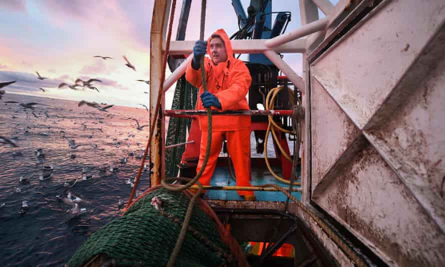 Crew members of the Radiant Star fishing in the North Sea off Shetland, Scotland.