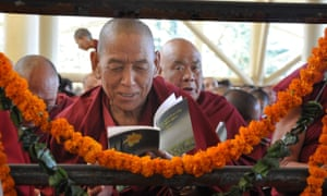 A Tibetan monk in exile prays at the Tibetan main Temple in north India town Dharamsala, India.