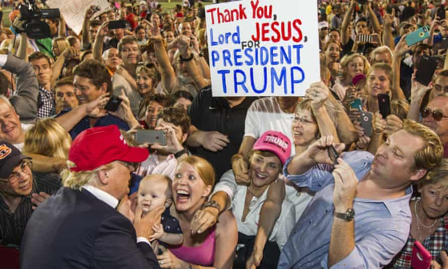 Presidential candidate Donald Trump greets supporters after his rally at Ladd-Peebles stadium in Mobile on Friday.