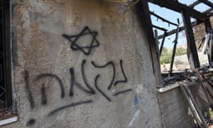 Hebrew graffiti reading 'Revenge' on the house of the Dawabsheh family in the West Bank village of Duma. A toddler and his parents were killed in the arson attack.