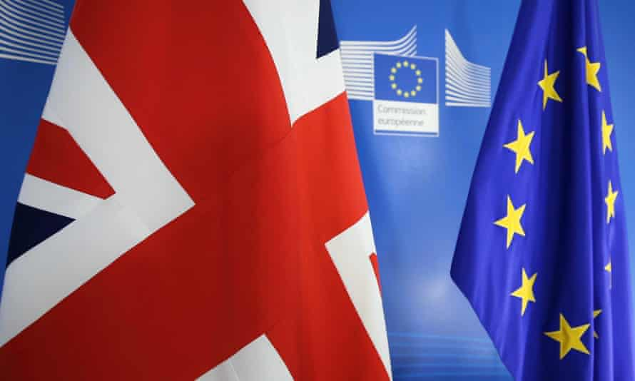 Flags are seen ahead of a joint press conference of Michel Barnier and Dominic Raab in Brussels, Belgium
