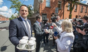 Fine Gael politicians Paschal Donohoe and Leo Varadkar hand out coffees on the campaign trail