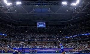 Novak Djokovic serves in majestic Arthur Ashe Stadium.