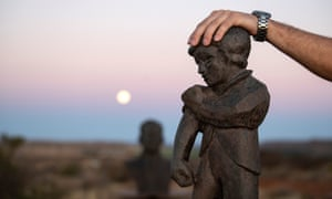 "Spokesperson of the Orania Beweging rests his hand on the town's mascot ""De Kleine Reus"" (The Little Giant) that symbolises the Oranians' belief in self reliance."