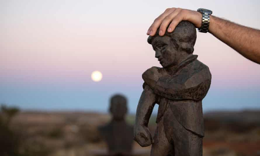 """Spokesperson of the Orania Beweging rests his hand on the town's mascot """"De Kleine Reus"""" (The Little Giant) that symbolises the Oranians' belief in self reliance."""