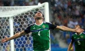 Gareth McAuley celebrates after scoring for Northern Ireland against Ukraine.