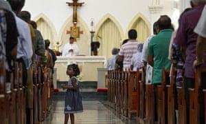 Catholics pray during a mass at St Theresa's church in Colombo, Sri Lanka