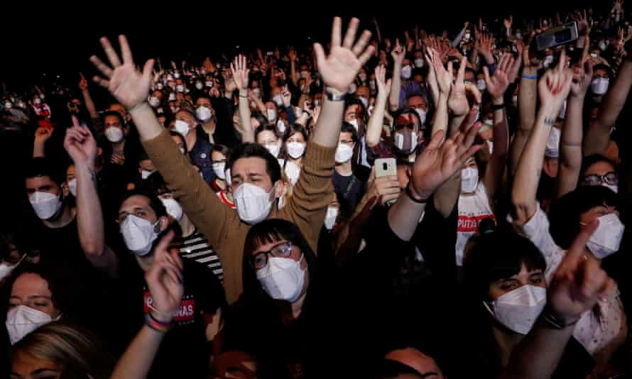 People attend the first major concert since the beginning of the Covid-19 pandemic in Barcelona