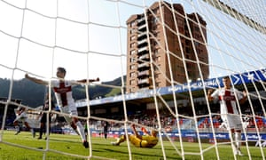Huesca players celebrate a goal in their win at Eibar.