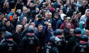 Police patrol right-wing demonstrators on 27 August in Chemnitz, eastern Germany