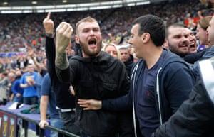 Spurs fans gesture at home fans