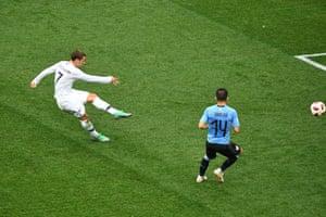 France's forward Antoine Griezmann shoots ...