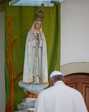 The pontiff prays in front of the statue of Our Lady of Fátima at the Chapel of the Apparitions.