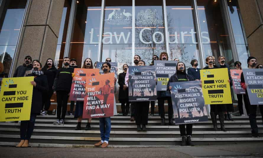 Greenpeace campaigners demonstrate outside the federal court in Sydney