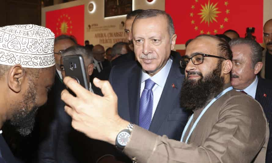 Turkish President Recep Tayyip Erdogan poses for a selife during an African Muslim Religious Leaders Summit