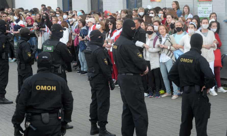 Belarusian police prepare to detain participants of the all-women protest in Minsk.