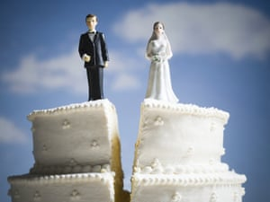 Wedding cake visual metaphor with figurine cake toppersRoyalty-Free Stock Imagery by Rubberball