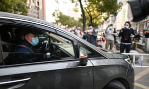 Peter Daszak (in vehicle) and other members of the World Health Organization (WHO) team investigating the origins of the Covid-19 pandemic arrive at Xinhua Hospital in Wuhan, Chinas central Hubei province.