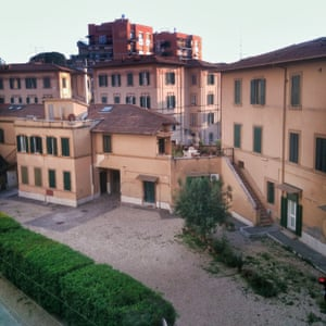 The view from Julien's living room window, the courtyard of a residential area in Rome.
