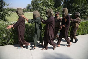 Jalalabad, Afghanistan Security officials parade a group of suspected militants after their arrest