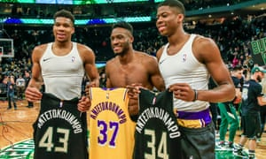 The Antetokounmpo brothers, Giannis (left), Thanasis and Kostas (right) swap jerseys after Thursday's game