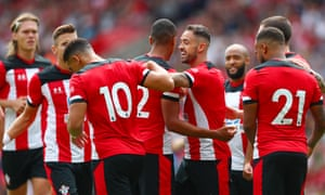 Danny Ings, fourth from right, celebrates with teammates after scoring his team's first goal in the friendly against FC Cologne.