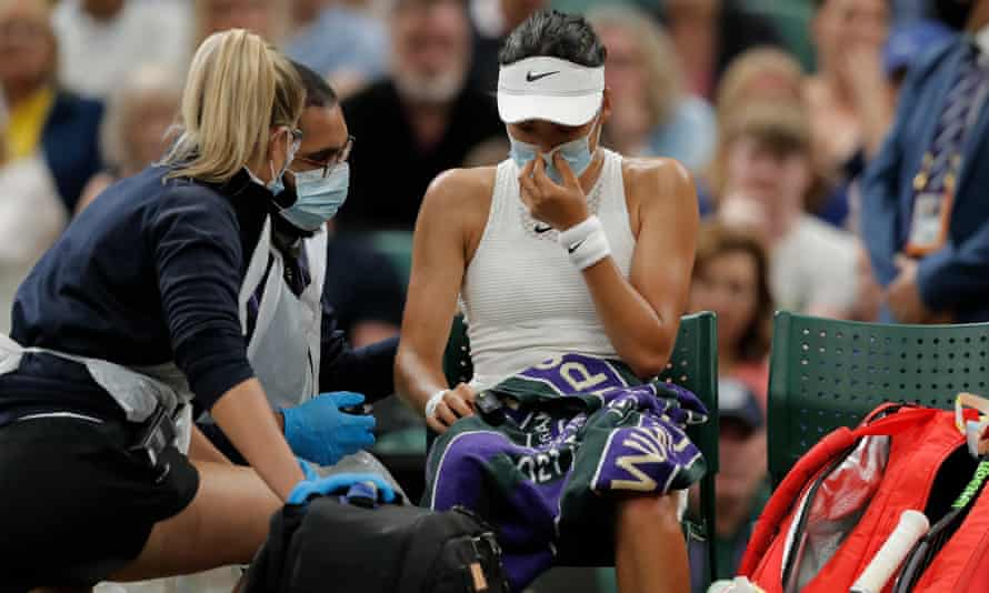Raducanu is checked by a doctor before going off court and retiring from her fourth-round match with Alja Tomljanovic at Wimbledon.