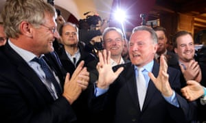 The AfD's Georg Pazderski and Joerg Meuthen celebrate the first exit polls of the Berlin city-state election.