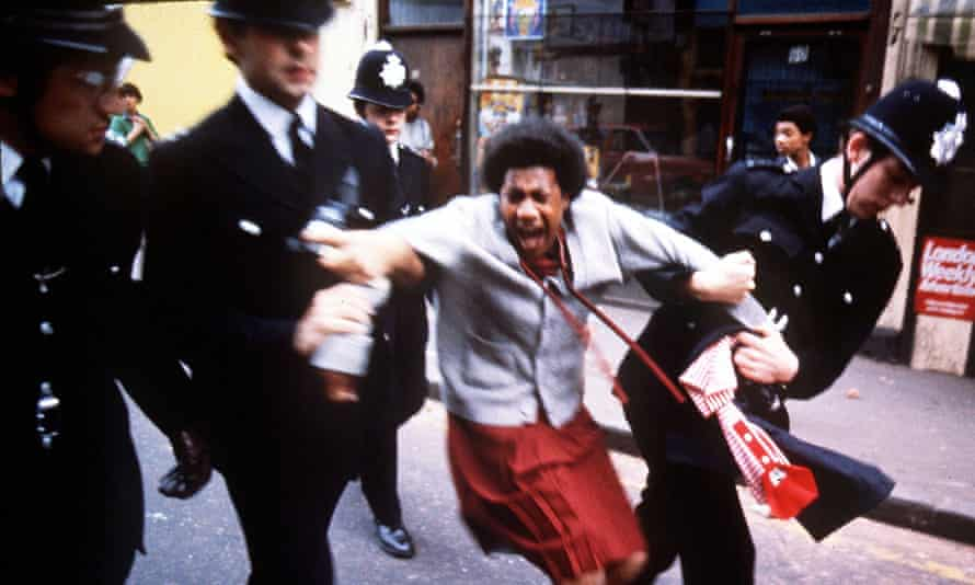 Police arrest a woman in the Brixton riots of 1981