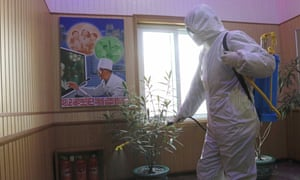 An official of the Hygienic and Anti-epidemic Center in Phyongchon District disinfect the corridor of a building in Pyongyang, North Korea, on Friday, 5 February 2021.