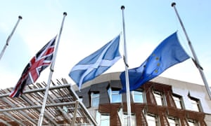 A union flag, a saltire and the EU flag fly outside the Scottish parliament in Edinburgh