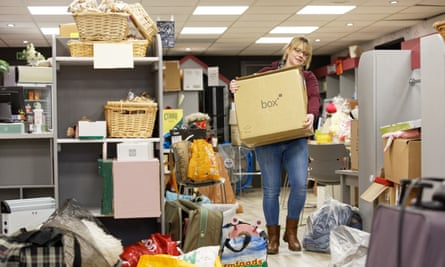 Karen Perry moves boxes of stock out of her charity shop in Taff Street, Pontypridd