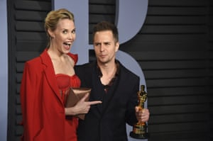 Leslie Bibb, left, and Sam Rockwell arrive at the Vanity Fair party with his Oscar for best supporting actor for his role in Three Billboards Outside Ebbing Missouri