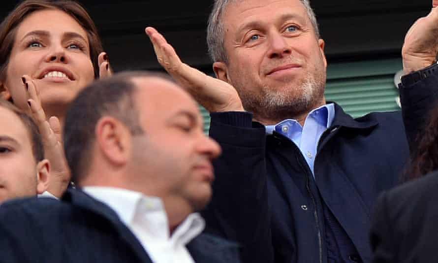 Roman Abramovich and Dasha Zhukova watch Chelsea play Arsenal at Stamford Bridge, London, in 2014.