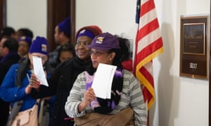 Furloughed contract workers hold unpaid bills to present to the office of the Senate majority leader, Mitch McConnell, 16 January.