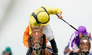 Addeybb and Tom Marquand get up to win the Champion Stakes.