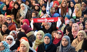 Tunisian women take part in a rally, held to mark the fifth anniversary of the 2011 revolution, on Habib Bourguiba Avenue in Tunis in January 2016