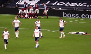 Tottenham Hotspur players look dejected as Manuel Lanzini of West Ham United celebrates with teammates after scoring his team's third goal.