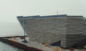 Cast stone panels are hung on the new V&A Dundee building.