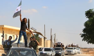 Syrian rebel fighters from the recently formed National Liberation Front parade in Idlib province.