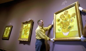 Golden glow … three versions of Van Gogh's sunflowers are hung in Amsterdam, 2002.
