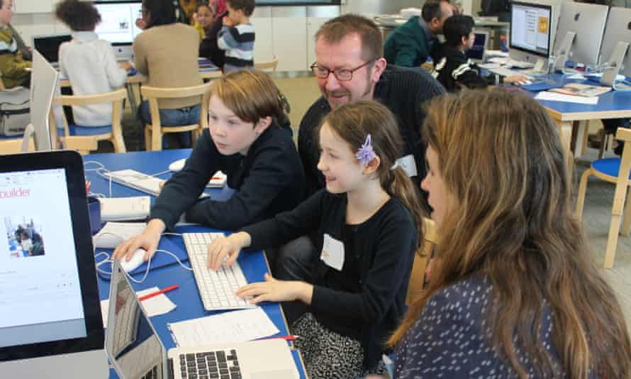 Families create front pages at the Education Centre